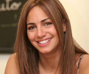 Arias pretendía que Valerie Dominguez promocionará AIS