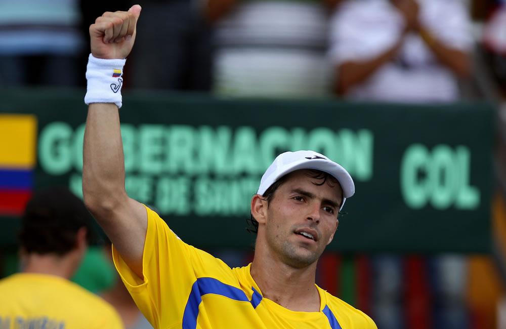 El tenista colombiano Santiago Giraldo celebra luego de vencer al uruguayo Marcel Felder. Foto: EFE