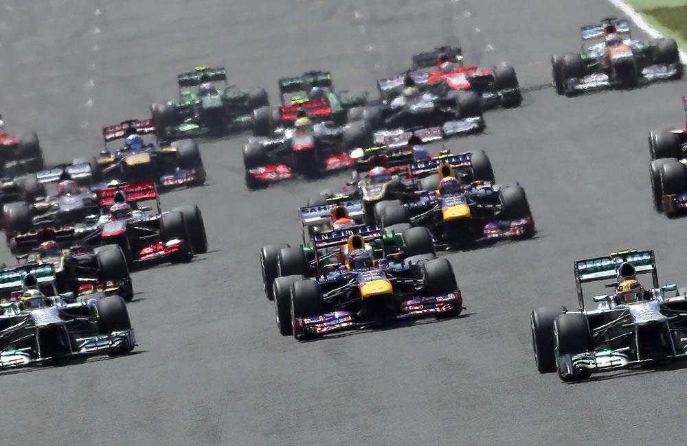 Los pilotos de Fórmula Uno durante la grilla de partida del Gran Premio de Gran Bretaña. Foto: EFE
