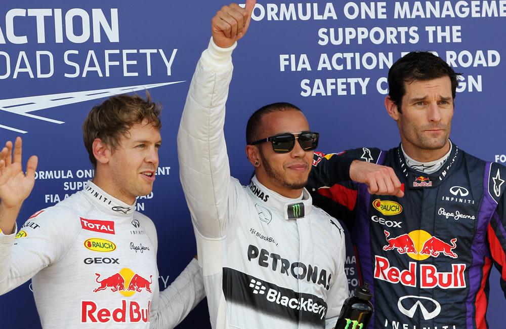 El piloto británico Lewis Hamilton junto a Sebastián Vettel y Mark Webber durante el Gran Premio de Alemania. Foto: EFE