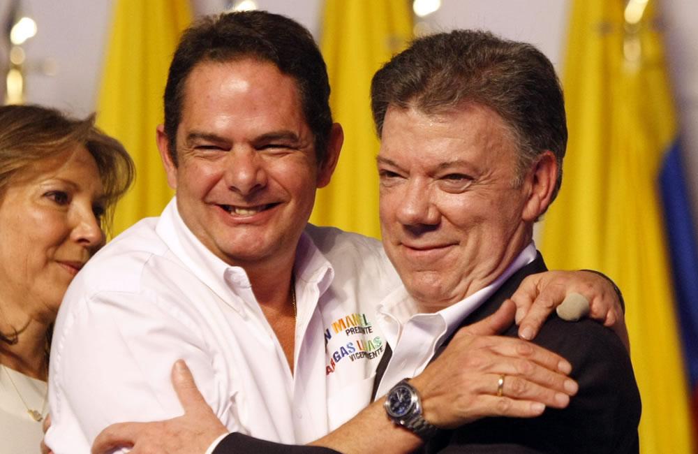 Juan Manuel Santos y Germán Vargas Lleras celebrando su triunfo. Foto: EFE