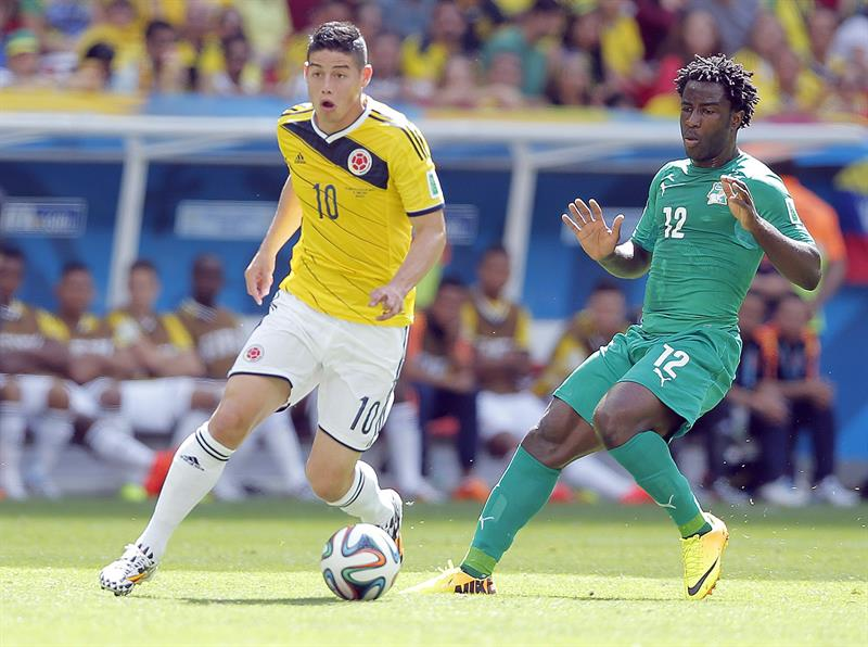 James Rodriguez of Colombia (L) and Wilfried Bony of Ivory Coast in action during the FIFA World Cup 2014 group C