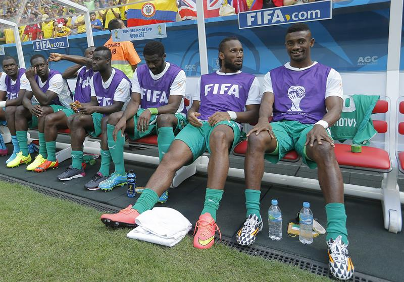 (R-L) Salomon Kalou, Didier Drogba and Kolo Toure sitting in the bench of Ivory Coast during the FIFA World Cup 2014 group C