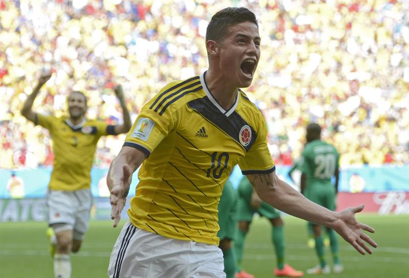 Colombia's James Rodriguez celebrates his 0-1 goal during the FIFA World Cup 2014 group C