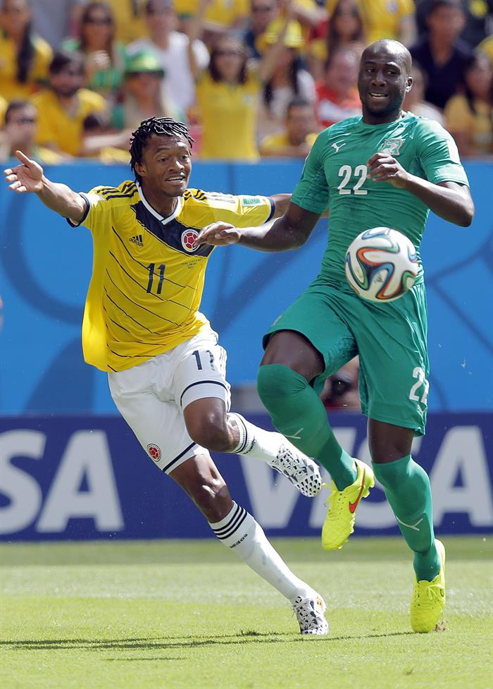 Juan Cuadrado of Colombia (L) and Souleymane Bamba of Ivory Coast in action during the FIFA World Cup 2014 group C