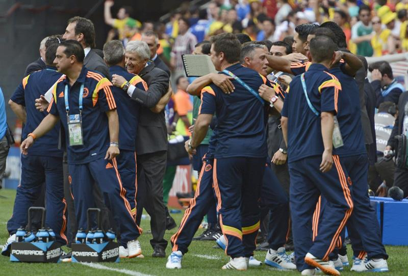 Colombia's staff celebrate after winning the FIFA World Cup 2014 group C