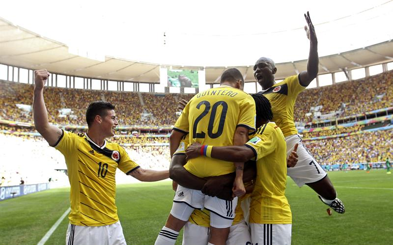 Colombian players and fans celebrate after Juan Quintero of Colombia scored the 2-0 during the FIFA World Cup 2014 group C