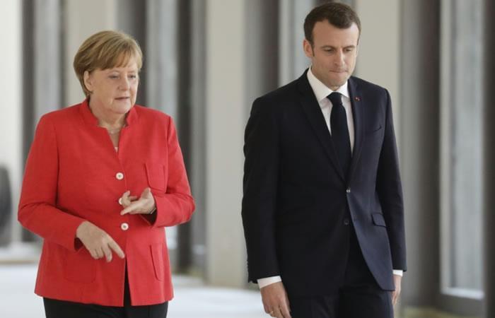 Merkel y Macron quieren devolver a los migrantes a los países de entrada en la UE
