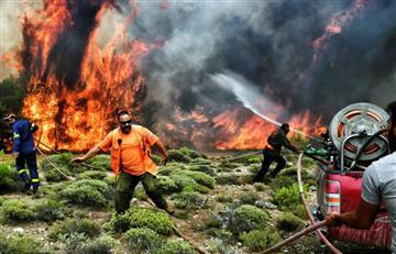 Grecia llora sus muertos y continúa luchando contra los incendios