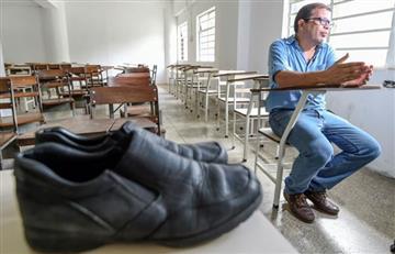 La historia detrás de los zapatos rotos de un profesor venezolano