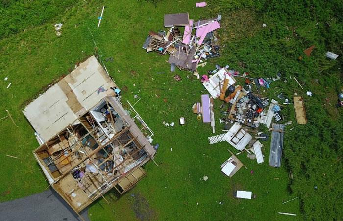 Una casa destruida por el huracán María, el 24 de septiembre de 2017, en Barranquitas, al sudoeste de San Juan, Puerto Rico. Foto. AFP.