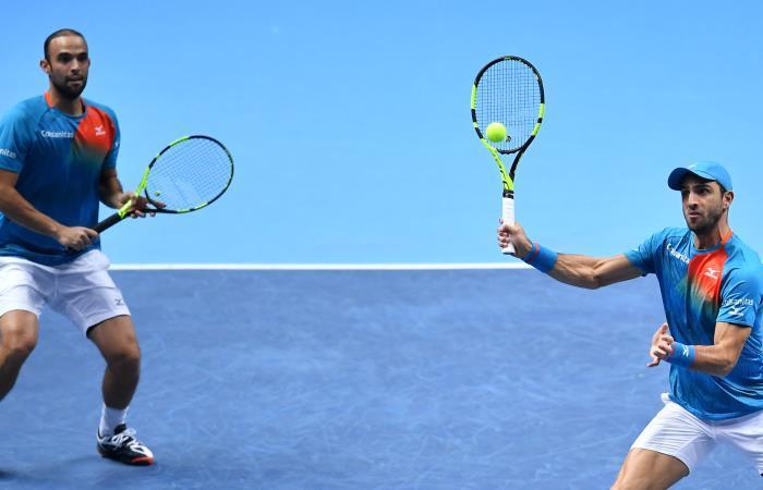 Juan Sebastián Cabal (I) y Robert Farah en acción. Foto: AFP