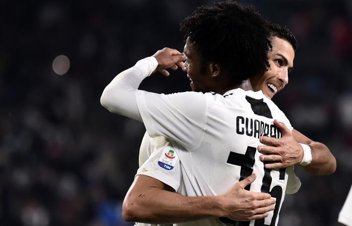 Cuadrado y Cristiano con Juventus. Foto: AFP