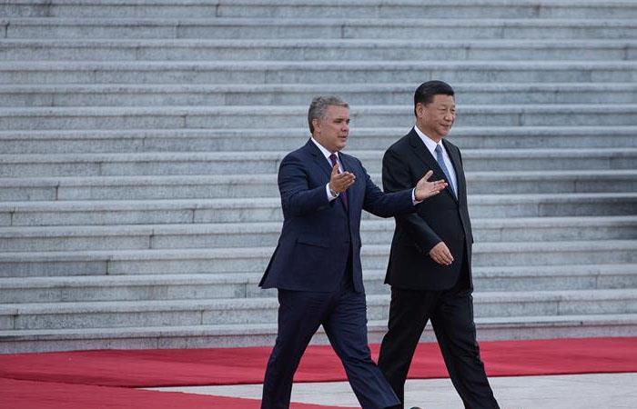 El presidente de China, Xi Jinping (d), y su homólogo colombiano, Iván Duque Márquez. Foto: EFE
