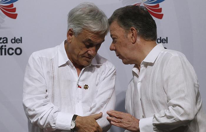 Sebastián Piñera, presidente de Chile, y Juan Manuel Santos, expresidente de Colombia. Foto: Twitter