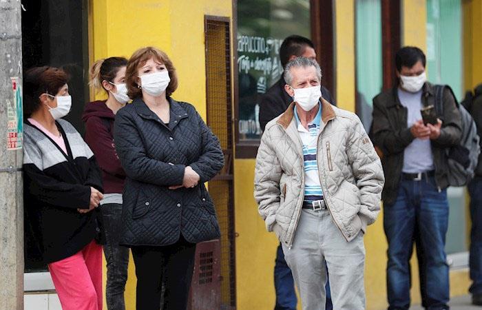 Restricción coronavirus Bogotá hombres mujeres
