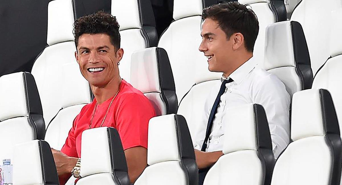 Paulo Dybala, junto a su compañero de equipo, Cristiano Ronaldo. Foto: EFE