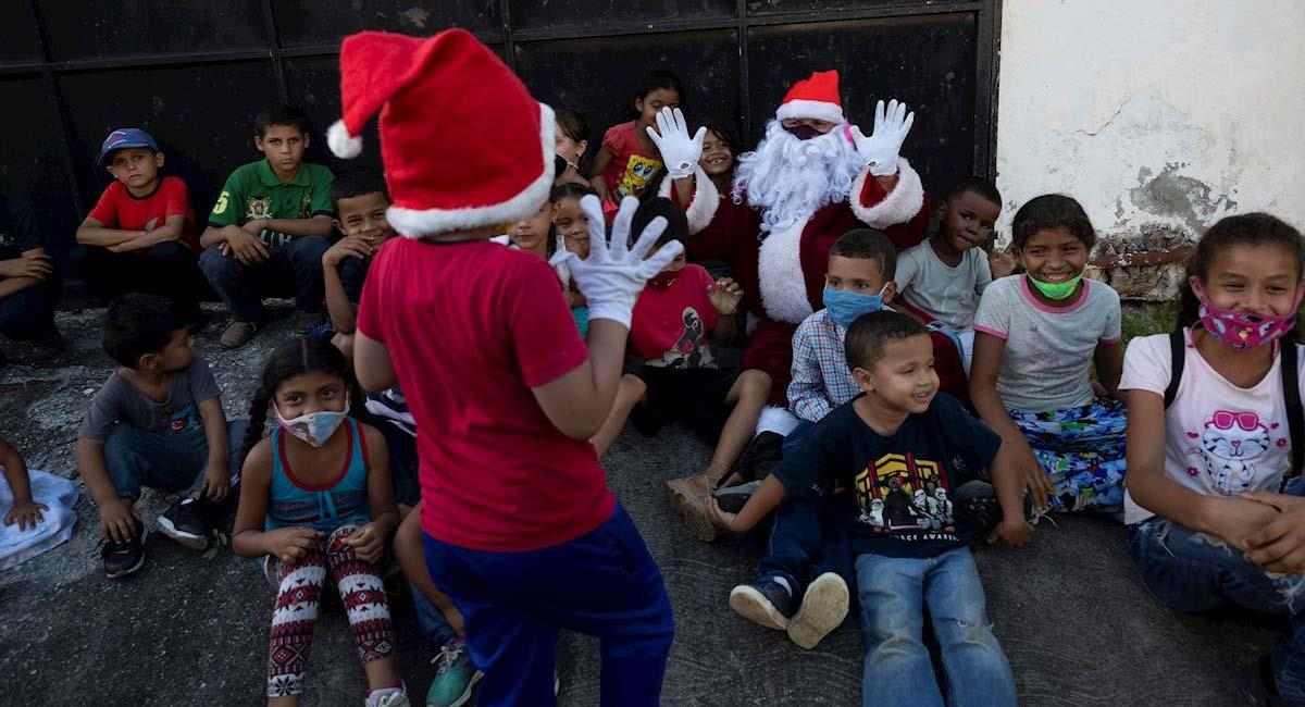 Niños disfrutan de la Navidad en Venezuela. Foto: EFE