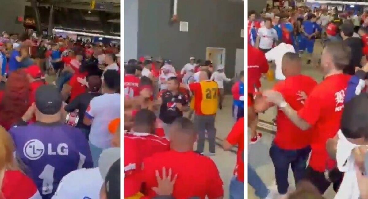 Fuerte pelea entre hinchas del América de Cali y Olimpia de Honduras. Foto: Twitter @BandaDelDiablo_