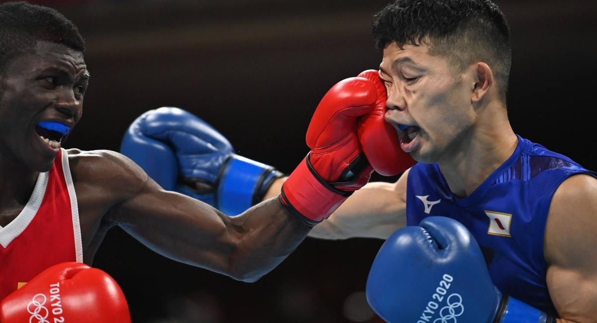 Yuberjen Martínez vs Tanaka. Foto: Reuters / Luis Robayo